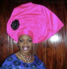 Lady with a Nigerian gele/head gear